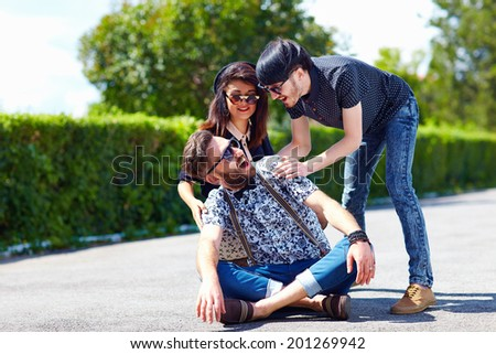 group of friends having fun on the street - stock photo