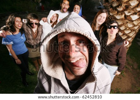 Group of friends having fun outside - stock photo