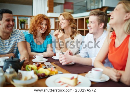 Group of friends having lunch at cafe - stock photo