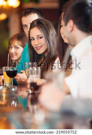 Group of friends in a bar - stock photo