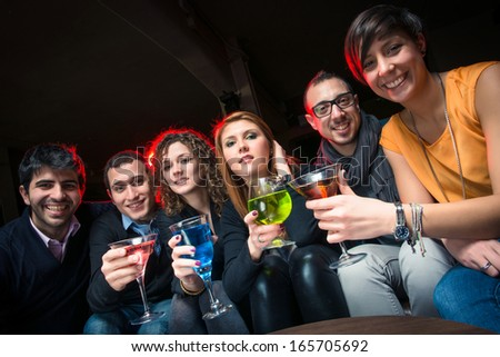 Group of Friends in a Night Club - Stock Image - stock photo