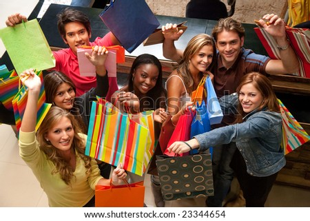 group of friends in a shopping mall looking up - stock photo