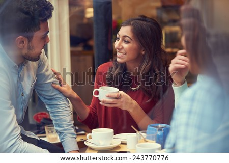 Group Of Friends In Caf�¢?? Relaxing Together - stock photo