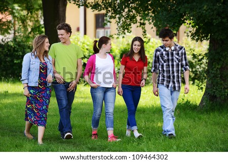 Group of friends in the park - stock photo