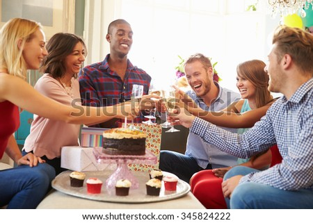 Group Of Friends Making A Toast To Celebrate Birthday - stock photo