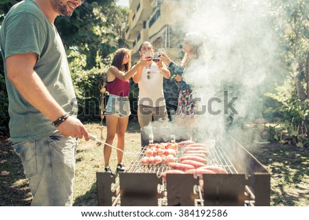Group of friends making barbecue in the backyard. concept about good and positive mood with friends - stock photo