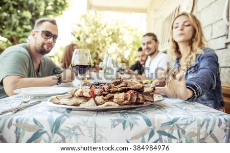 Group of friends making barbeque in the backyard. concept about good and positive mood with friends - stock photo