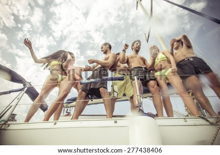 group of friends making party on the boat. concept about transportation, fun, happiness,youth, boat and people - stock photo