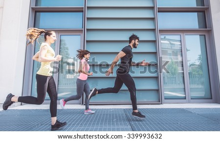Group of friends making urban running and fitness.