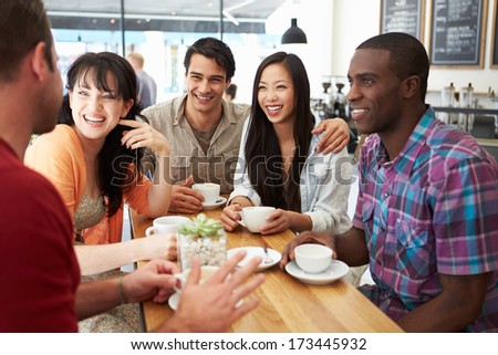 Group Of Friends Meeting In Coffee Shop - stock photo