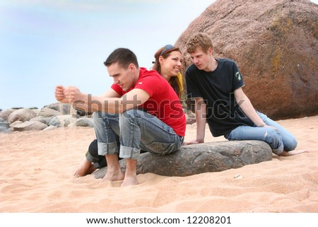 group of friends on the beach - stock photo