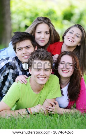 Group of friends relaxing in the park - stock photo