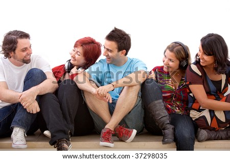 Group of friends sitting on the floor isolated - stock photo
