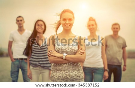 Group of Friends stay on the pier. - stock photo