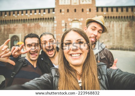 Group of friends taking a selfie - Tourists taking a photograph at Sforza Castle in Milan,Italy - stock photo