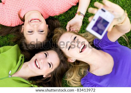 Group of friends taking photo - stock photo