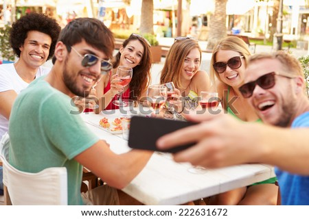 Group Of Friends Taking Selfie During Lunch Outdoors - stock photo