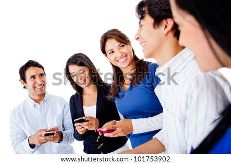 Group of friends texting on their mobile phones - isolated over a white background - stock photo