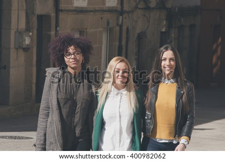 group of friends walking - stock photo