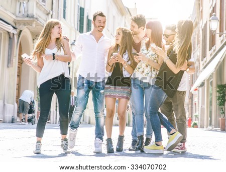 Group of friends walking in the city center and having fun. - stock photo
