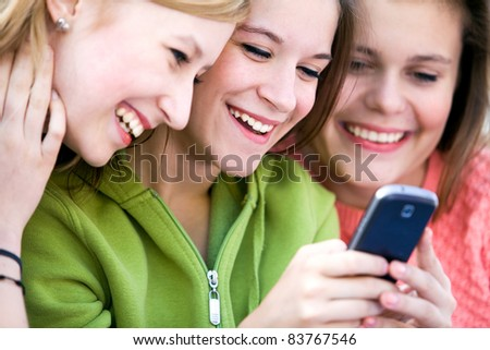 Group of friends with cellphone - stock photo