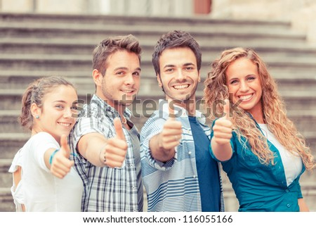Group of Friends with Thumbs Up - stock photo