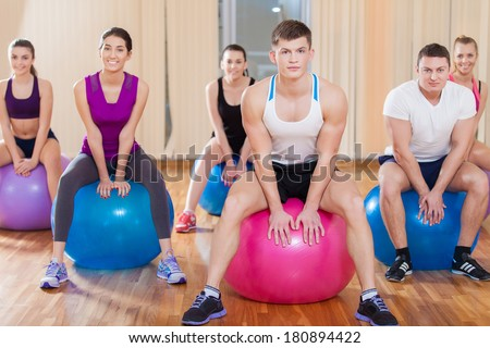 Group of friends working out at the fitness center - stock photo