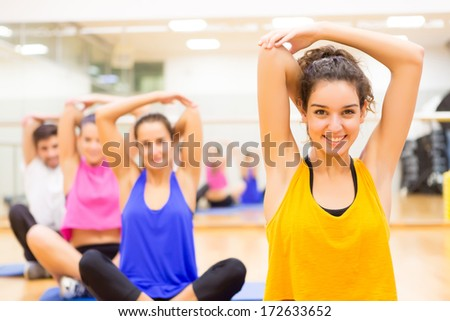 Group of friends working out at the gym - stock photo
