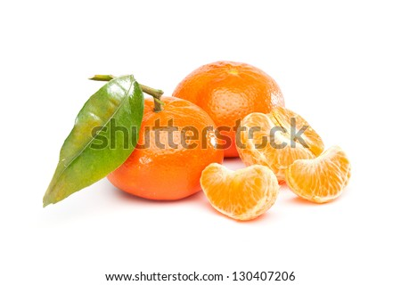 Group of fruits  with different names: Tangerine, mandarine or clementine. Full one and pieces. Isolated on white background. - stock photo