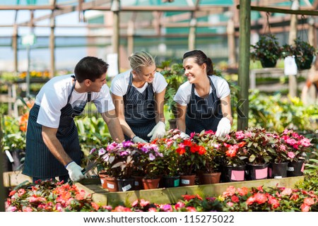 group of garden workers working in nursery - stock photo