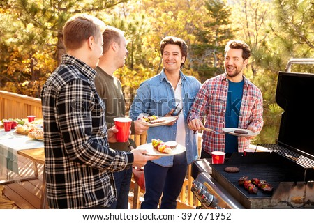 Group Of Gay Male Friends Enjoying Barbeque Together - stock photo