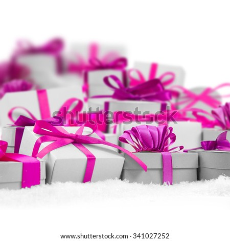 Group of gifts with colorful ribbons on white background, defocused gifts behind; white space for text - stock photo