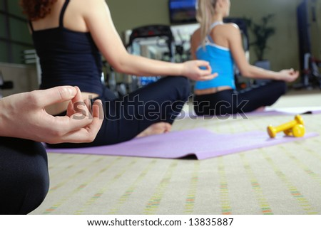 group of girl exercising yoga in fitness club - stock photo