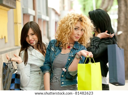 Group of girls coming back from shopping - stock photo
