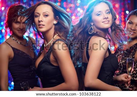 Group of girls having fun at nightclub - stock photo
