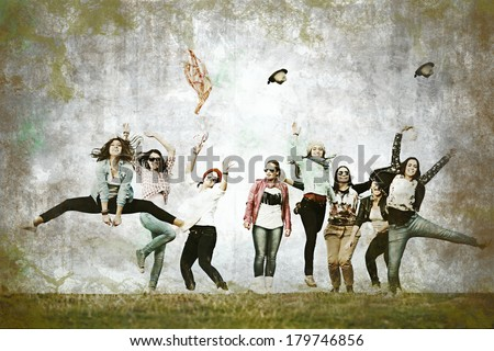 Group of girls in retro style having fun time outdoors jumping up in air