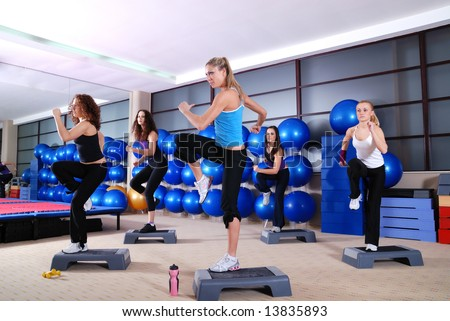 group of girls stepping in a fitness club - stock photo