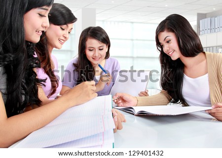 group of girls studying together in campus - stock photo
