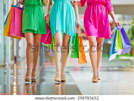 Group of glamorous shoppers walking in the mall - stock photo