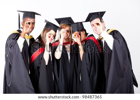 group graduates looking through their diploma stock photo  group of graduates looking through their diploma