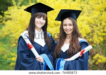 group of graduation students in the park cheerful and happy - stock photo