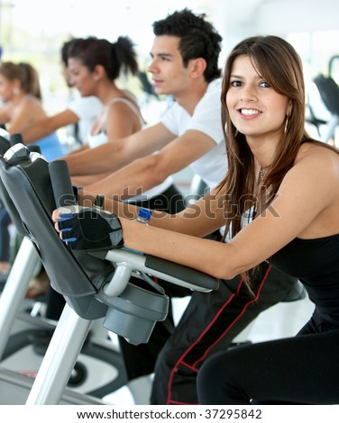 Group of gym people exercising on cardio machines - stock photo