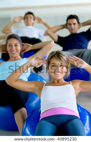 group of gym people in a pilates class