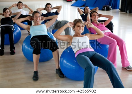 group of gym people in a pilates class - stock photo