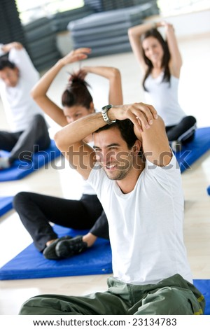 Group of gym people stretching at a gym