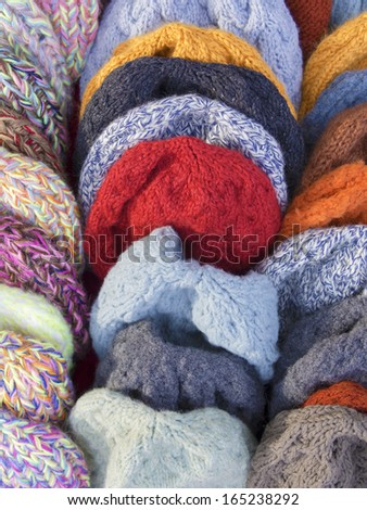 group of hand-knitted hats from natural organic wool  , woolen  caps - stock photo