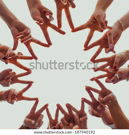 Group of hands forming a star shape  - stock photo