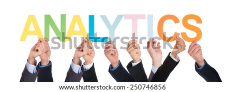 Group Of Hands Holding Colorful Word Analytics Over White Background - stock photo