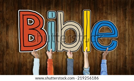 Group of Hands Holding Letter Bible - stock photo