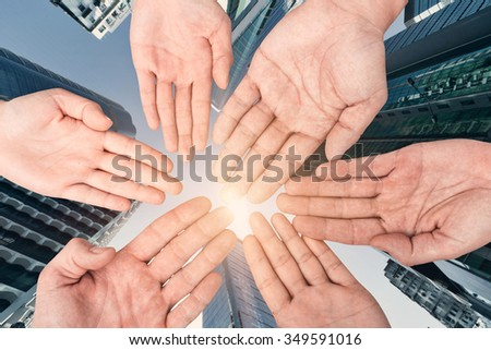 Group of hands holding together, conept of all, team, together etc. - stock photo